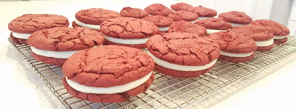 Easy Red Velvet Sandwich Cookies sitting on a cooling rack
