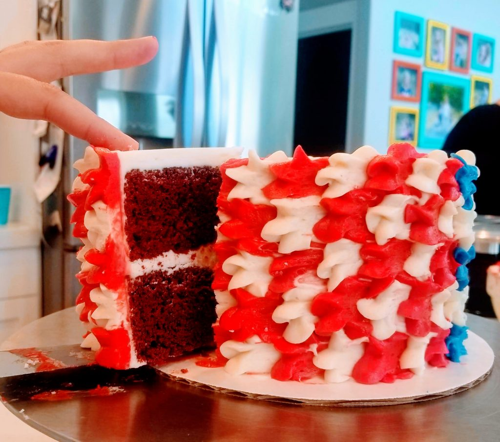 American Decadent Red Velvet Cake being cut