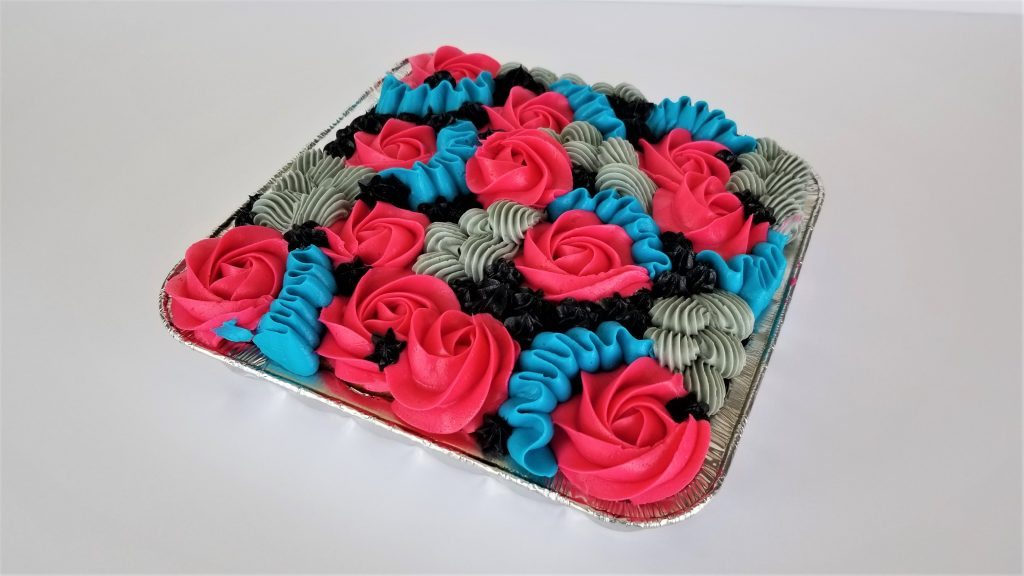 Sheet Cake decorated with simple and colorful piping.