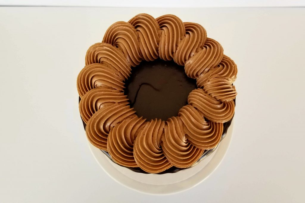 Top View of a Triple Chocolate Cake with a rope boarder