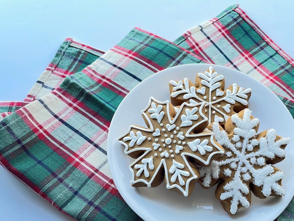 Soft Roll-Out Gingerbread Snowflake Cookies Decorated with Royal Icing